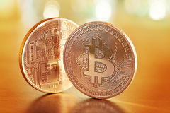 Golden Bitcoins. Photo .Golden Bitcoins on a gold background (new virtual money royalty free stock image