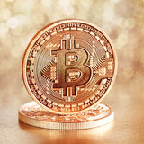 Golden Bitcoins. Photo .Golden Bitcoins on a gold background (new virtual money royalty free stock images