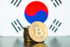 Golden bitcoins and South Korea flag. Digital cryptocurrency royalty free stock photos