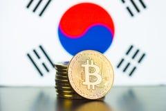 Golden bitcoins and South Korea flag. royalty free stock photos