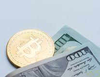 Golden Bitcoins on US dollars. Digital currency close-up. New virtual money. Crypto currency top view. Real coins of bitcoin on ba stock photography
