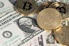 Golden Bitcoins on US dolllars close up image. Bitcoin virtual money and banknotes of dollars. stock image