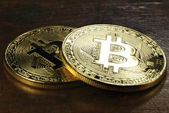 Bitcoins. Golden bitcoins on wooden background stock photography