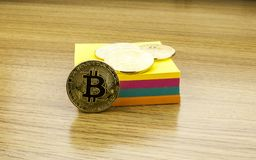 Golden bitcoins on wooden desk, cryptocurrency background with paper notes.3D illustration. Golden bitcoins on wooden desk, cryptocurrency background with paper Stock Image