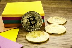 Golden bitcoins on wooden desk, cryptocurrency background with paper notes.3D illustration. Golden bitcoins on wooden desk, cryptocurrency background with paper Royalty Free Stock Images