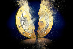 Golden Bitoin breaks in two Stock Image
