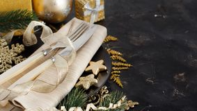 Golden and black Christmas Table Setting. With christmas decorations royalty free stock image