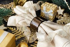 Golden and black Christmas Table Setting. With christmas decorations stock photos