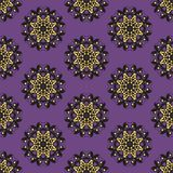 Golden and black ornament pattern on purple background stock photo