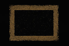 Golden blank frame on a black background. Royalty Free Stock Images