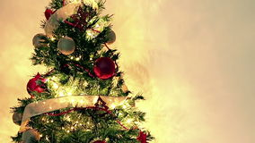 Golden blinking Christmas tree lights on gold warm background, festive holiday stock video footage