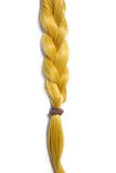 Golden blond hair braided in pigtail. Isolated on white background Royalty Free Stock Images