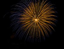 Golden blue amazing fireworks isolated in dark background close up with the place for text Stock Photo