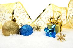 Golden and blue christmas decoration on snow Royalty Free Stock Photos