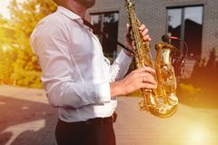 Golden Blues. Boys Band saxophone section at event , jazz player male playing on Saxophone, music instrument played by man saxopho. Nist player musician at  folk stock photography
