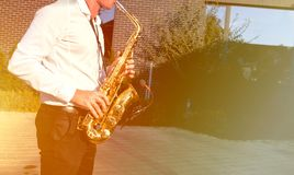 Golden Blues. Boys Band saxophone section at event , jazz player male playing on Saxophone, music instrument played by man saxopho. Nist player musician at  folk stock photo