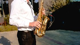 Golden Blues. Boys Band saxophone section at event , jazz player male playing on Saxophone, music instrument played by man saxopho stock photo