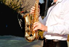 Golden Blues. Boys Band saxophone section at event , jazz player male playing on Saxophone, music instrument played by man saxopho royalty free stock photography