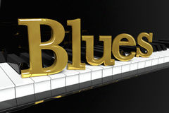 Golden Blues Sign. Music Concept. Black piano keys with golden Blues sign Stock Image
