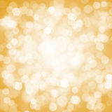 Golden blurred lights. Golden blurred, out of focus lights Royalty Free Stock Image