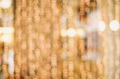 Golden blurry Christmas chain lights creating a beautiful bokeh Royalty Free Stock Photos