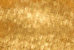 Golden blurry circle background Stock Photo