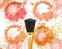 Golden blush make up on crushed make up powder. Golden blush make up on crushed make up powder royalty free stock photography