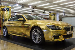 Golden BMW at the Frankfurt Airport Stock Image