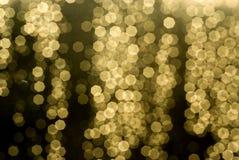 Golden Bokeh. Strings of glittering golden bokeh Stock Images