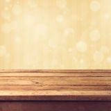 Golden bokeh background. With wooden table Royalty Free Stock Photo