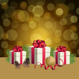 Golden bokeh background and christmas gift boxes with decoration ball. Glowing bokeh background and christmas gift boxes Stock Photography