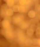 Golden bokeh background Stock Photos