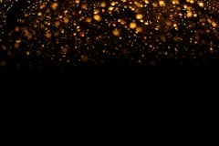 The golden bokeh blurred abstract pattern background.  royalty free stock photo