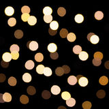 Golden bokeh on a dark background. Defocused bokeh lignts. Abstract Christmas background. Abstract circular bokeh background of Ch Stock Image