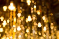 Golden bokeh. Shinny on dark background stock images