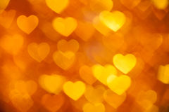 Golden bokeh of hearts background Stock Image