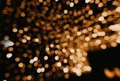Golden bokeh lights blurred background royalty free stock images