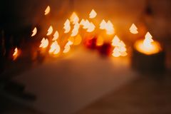 Golden red bokeh new year and Christmas decorations, defocused Royalty Free Stock Photography