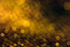 Golden Bokeh Shapes on Black Royalty Free Stock Photos