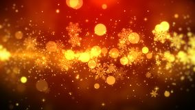 Golden bokeh and snowflakes lights on red background with Christmas theme.  Royalty Free Stock Photography