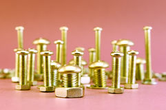 Golden Bolts and nuts Stock Photo
