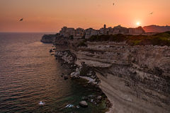 Golden Bonifacio. A classic view of Bonifacio's spectacular 'Upper City', at the southern tip of the island of Corsica lit in a warm glow during sunset Royalty Free Stock Photography