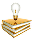Golden books and creative bulb Stock Photo