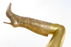 Golden boot. Detail of woman wearing golden boot Stock Images
