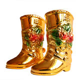Golden boot. On white background Stock Photography