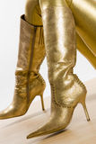 Golden boots Royalty Free Stock Photos