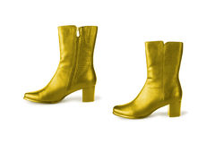 Golden boots Royalty Free Stock Image