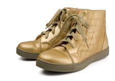 Golden boots Stock Photos