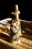 Golden bottle champaign. Golden bottle of champaign with decoration Royalty Free Stock Photos