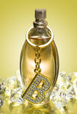 Golden Bottle Of Perfume Royalty Free Stock Images